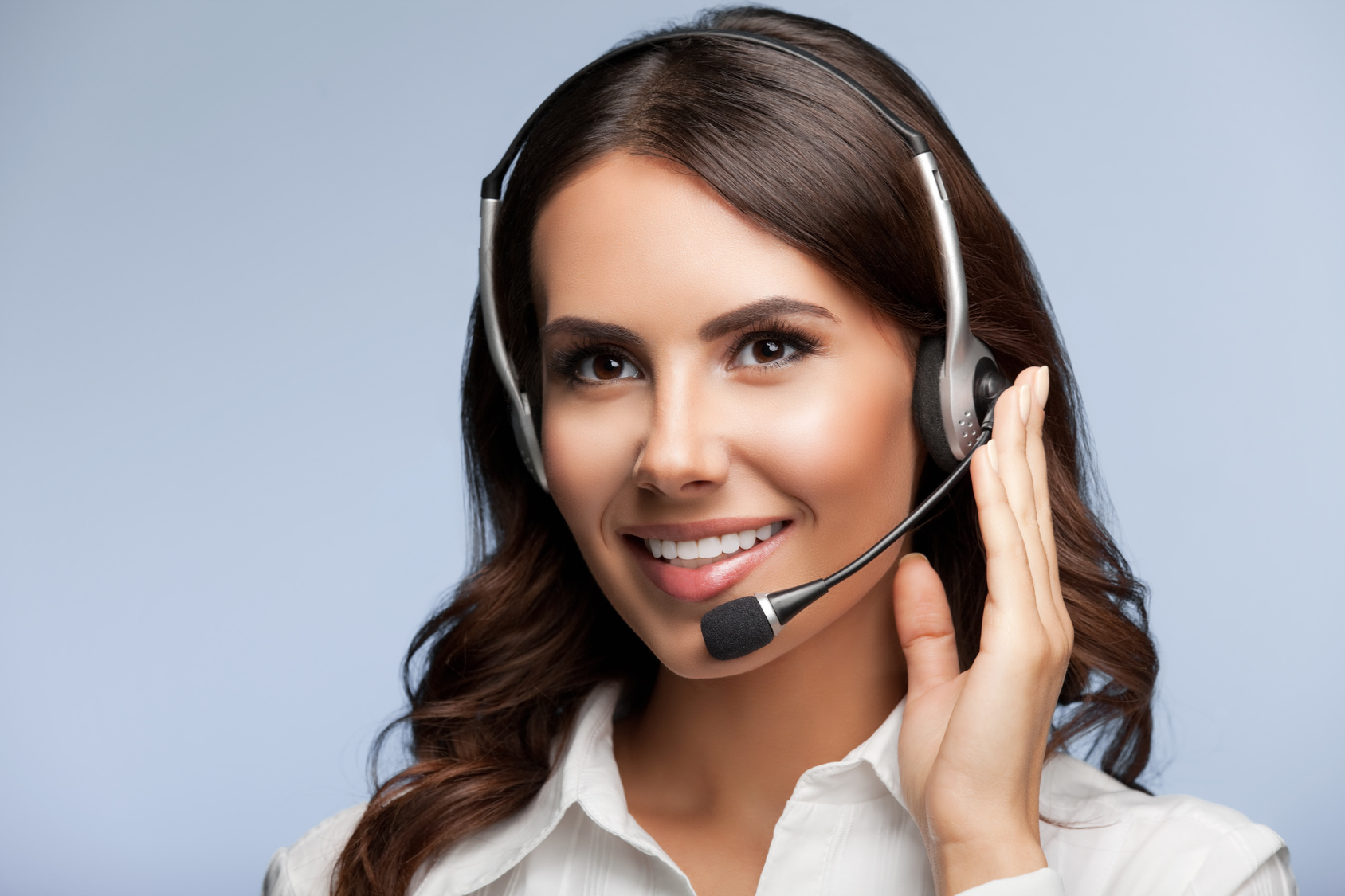 Portrait of cheerful customer support female phone operator in h
